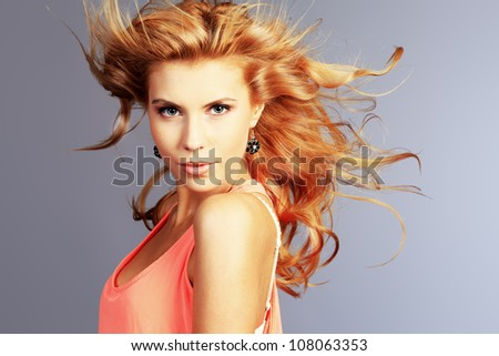 Portrait of a smiling young woman with beautiful hair.