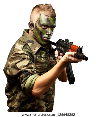 Portrait Of A Soldier Aiming With Gun On White Background - stock photo