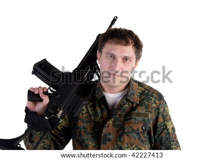 Portrait of a soldier holding a gun (isolated on white)