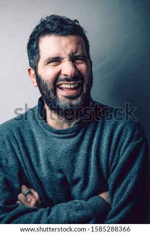 Portrait of a 40-something year old man, laughing. good mood, good energies, good vibes, positive vibrations.