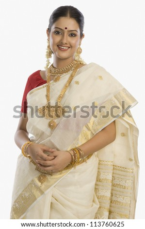 Portrait of a South Indian woman wearing jewelry and sari