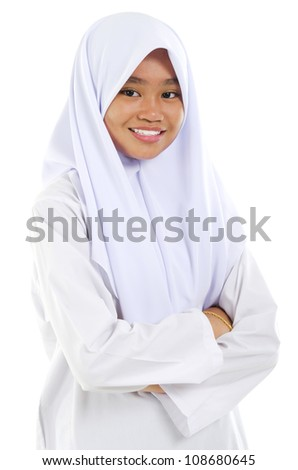 Portrait of a Southeast Asian Muslim teen crossed arms over white background
