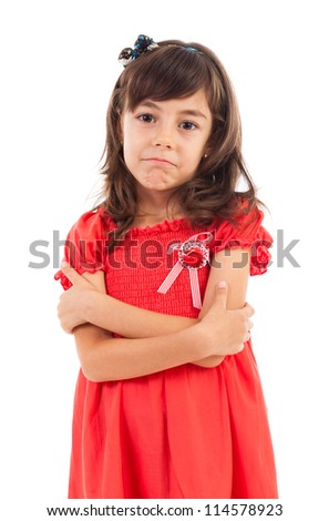 Portrait of a spoiled cute girl with crossed arms isolated on white