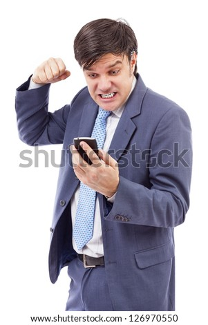 Portrait of a  stressed businessman getting bad news by phone isolated on white.