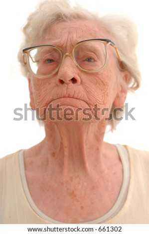 Portrait of a stubborn mature woman in her eighties. Photographed on white.