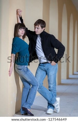 Portrait of a student couple posing outside building in the gallery love relation concept