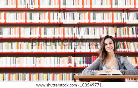 Portrait of a student  girl studying at library