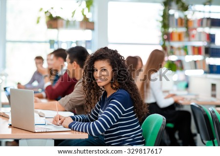 Portrait of a students studying in university library