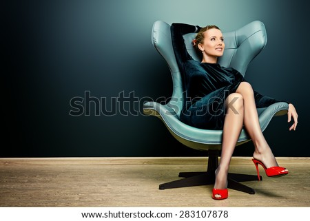 Portrait of a stunning fashionable model sitting in a chair in Art Nouveau style. Business, elegant businesswoman. Interior, furniture. #283107878