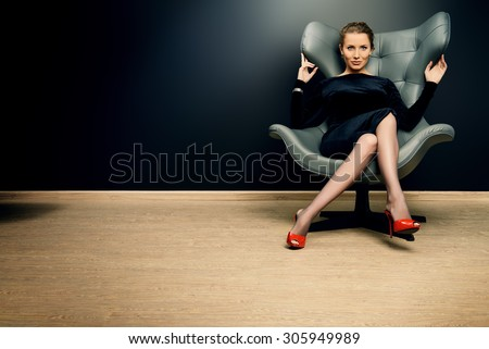 Portrait of a stunning fashionable model sitting in a chair in Art Nouveau style. Business, elegant businesswoman. Interior, furniture. #305949989
