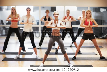 Portrait of a stunning young woman leading an aerobics class