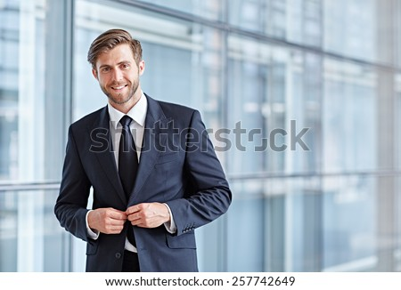 Portrait of a stylish corporate executive smiling confidently at the camera