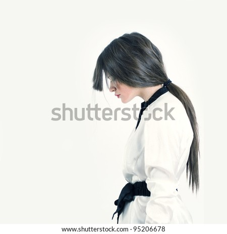Portrait of a stylish woman on a white background.