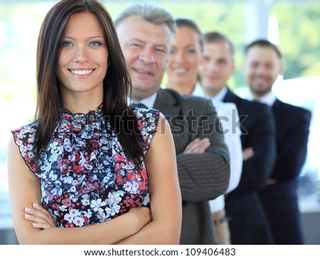 Portrait of a stylish young businesswoman with her successful business team at office
