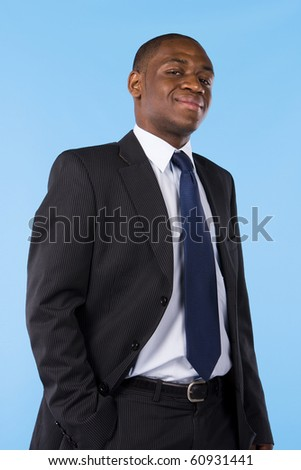 Portrait of a successful business man isolated on a blue background