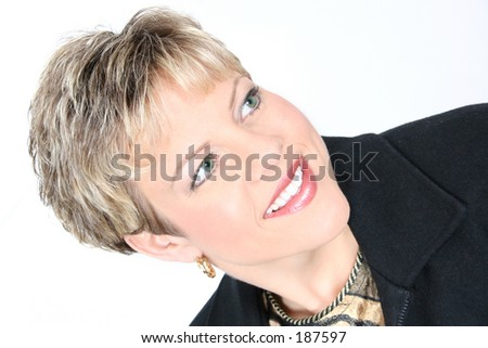 Portrait of a successful business woman in a black and animal print business jacket and shirt.