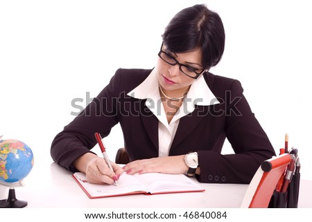 Portrait of a successful business woman writing at her desk isolated over white background