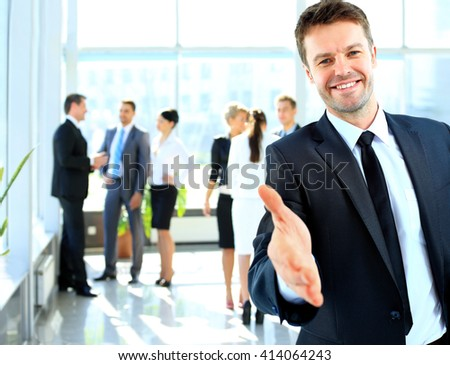 Portrait of a successful businessman giving a hand #414064243