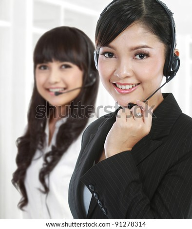 Portrait of a successful female call centre employee wearing a headset. in white background