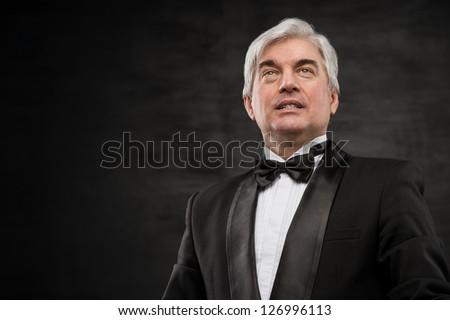 Portrait of a successful mature business man smiling - Copyspace