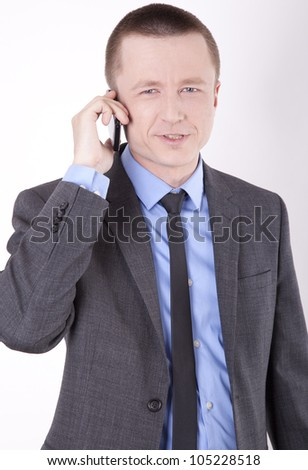 Portrait of a successful young business man talking on a phone.