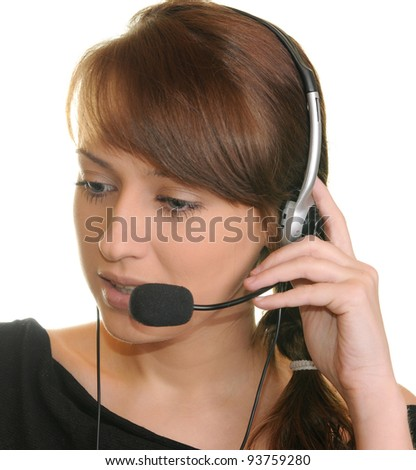 Portrait of a successful young female call center employee wearing a headset against white background