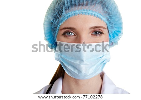 Portrait of a surgical nurse with mouth guard and hairnet