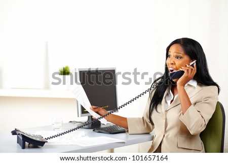 Portrait of a surprised business female speaking on phone