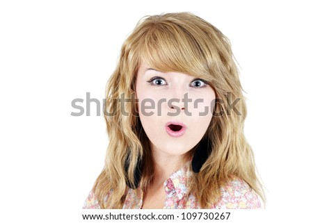 Portrait of a surprised pretty young blond girl teenager isolated over white background