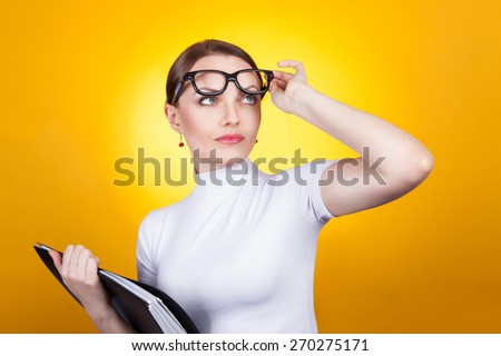 Portrait of a surprised woman. Woman in glasses with documents surprised. Lookup lifting points