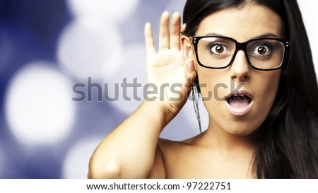 portrait of a surprised young woman hearing a sound against an abstract background