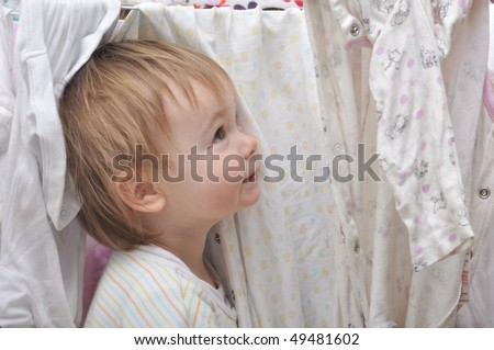 portrait of a sweet girl with the clothesline - stock photo