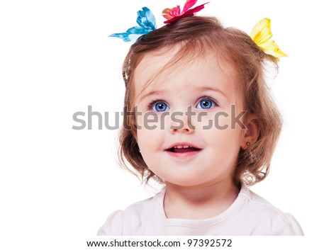 Portrait of a sweet little girl with butterflies on head