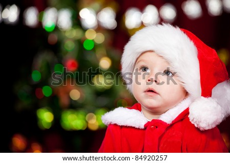 Portrait of a sweet toddler in Santa hat