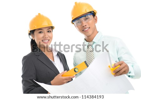 Portrait of a team of architects being ready for work isolated against white background