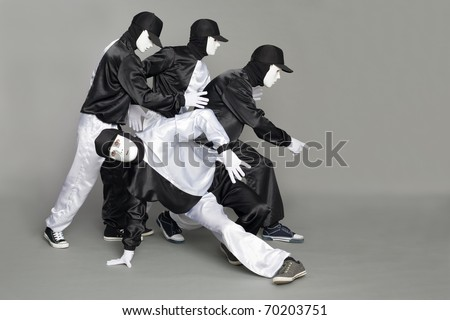 Portrait of a team of young break dancers with elements of dance in mask. - stock photo