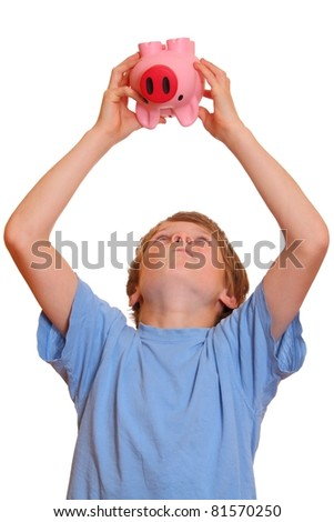 Portrait of a teenage boy trying to empty his piggy bank