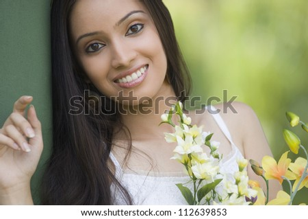 Portrait of a teenage girl with bouquet of flowers