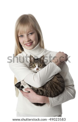 Portrait of a teenage girl with her pet cat at white background