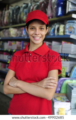 portrait of a teenage girl working part time in a stationery  shop