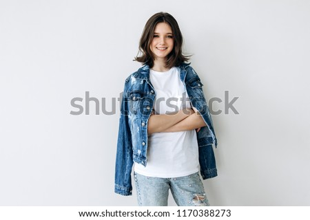 Portrait of a teenage girl 12-14 years old on a white background. Stock photo ©