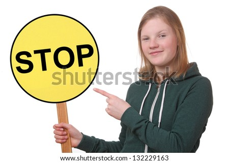 Portrait of a teenager holding a stop sign on white background