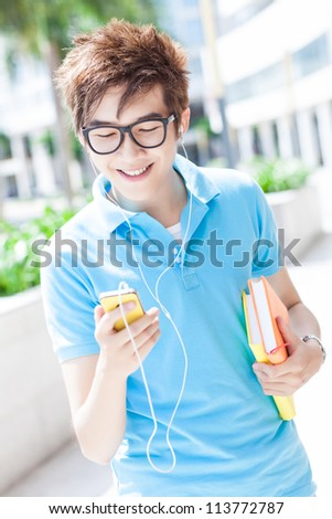 Portrait of a teenager listening to music on his mobile phone