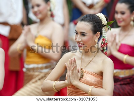 Portrait of a Thai woman.: Thai traditional dance. This is the parade of making traditional merit of people from the northern territory of Thailand