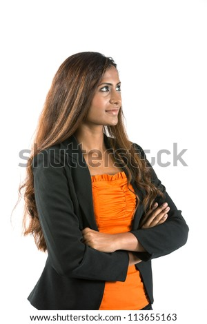 Portrait of a thoughtful Indian Business woman looking to her right.  Isolated on white background.