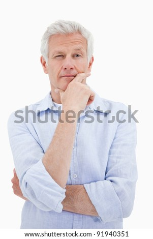 Portrait of a thoughtful mature man against a white background