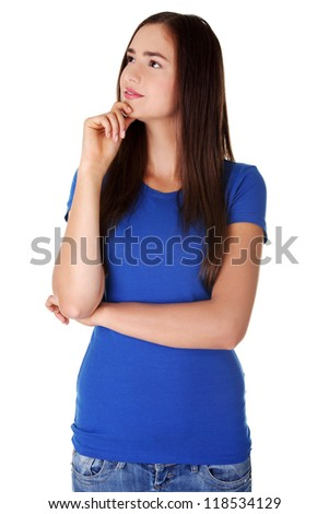 Portrait of a thoughtful young woman looking up - isolated on white