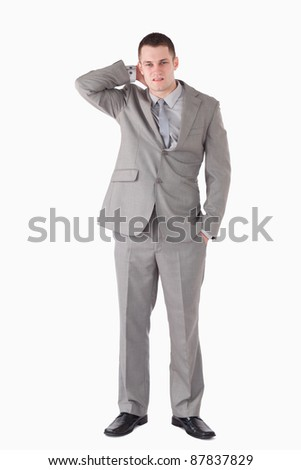 Portrait of a tired businessman against a white background
