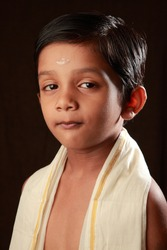 Portrait of a traditionally dressed smiling Indian Hindu boy