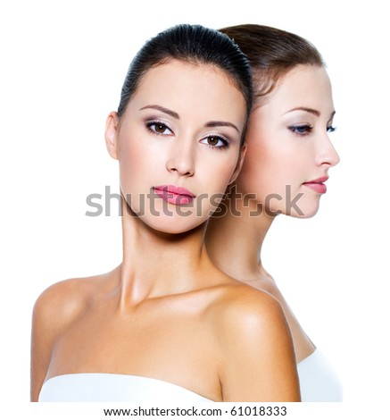 Portrait of a two beautiful sexy young women - Isolated on white